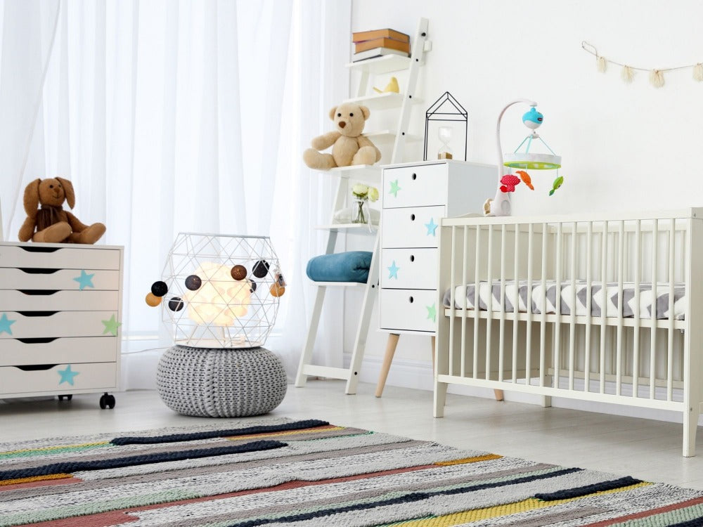 Baby's nursery with neutral white furniture