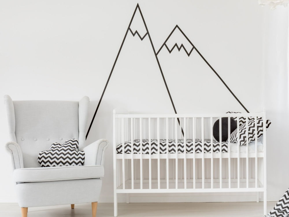 Baby's nursery with large mural