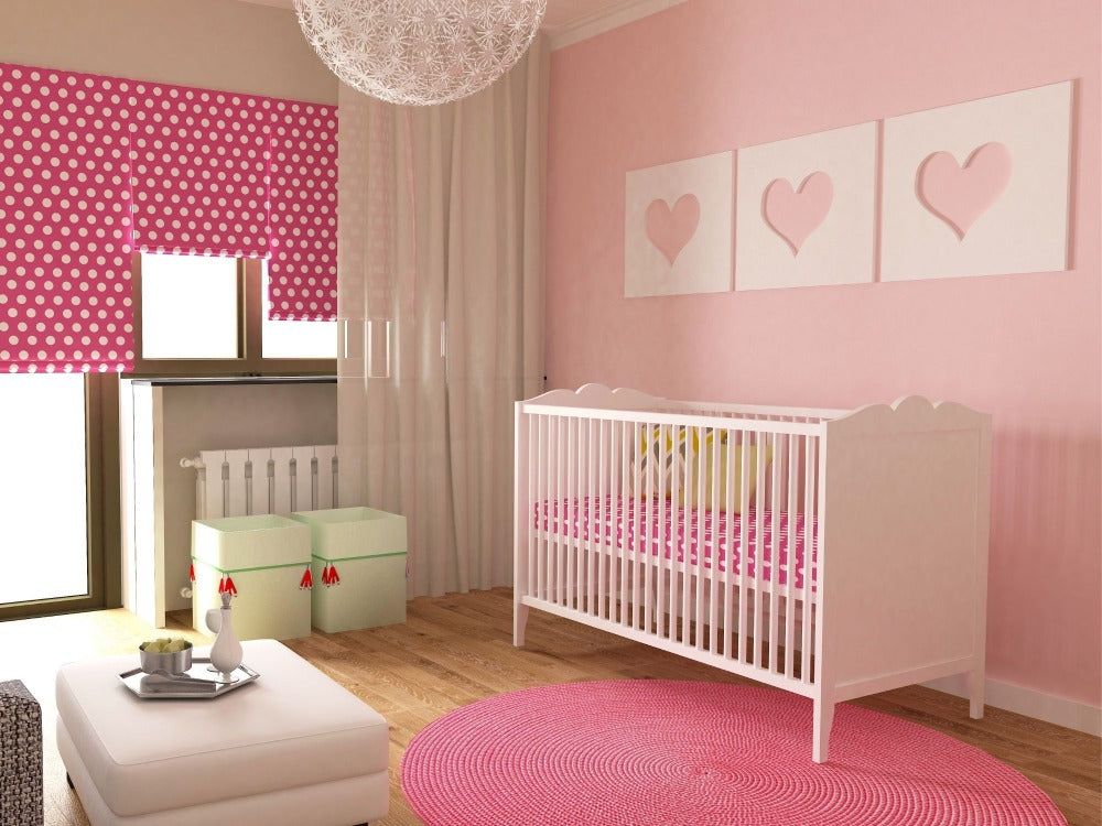 Baby's nursery with pink decor theme