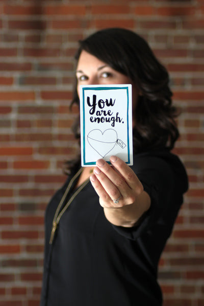 "Stacy Davison, holding a Personal Pep Talk strategy card that says ""you are enough"""