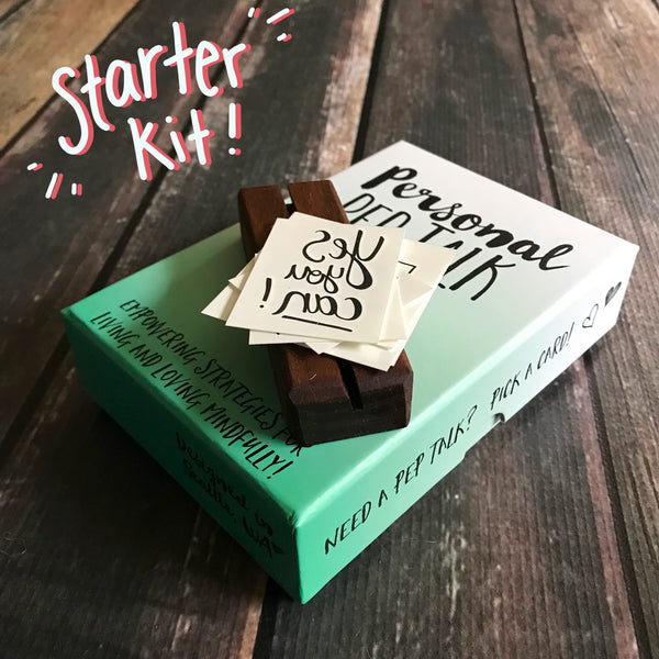 A personal pep talk starter kit with a mindfulness strategy card deck, inspiring temporary tattoos, and handcrafted wood display block