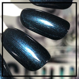 Montenegro Nights - a deep dark blue shimmering nail polish, laced with aqua, pink and purple microglitters