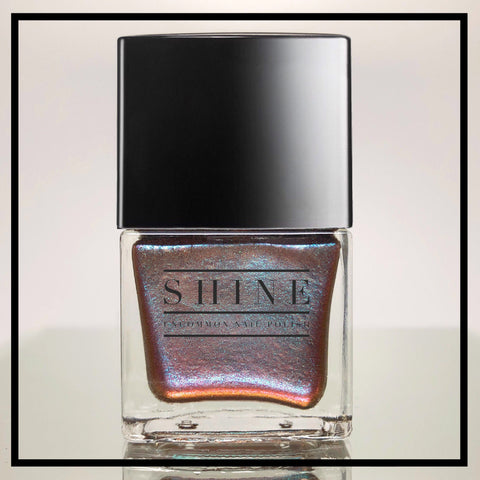 Mirage – A beguiling blend of Sepia Red, Brown and Gold, Laced w/ Glistening Aqua Nail Polish