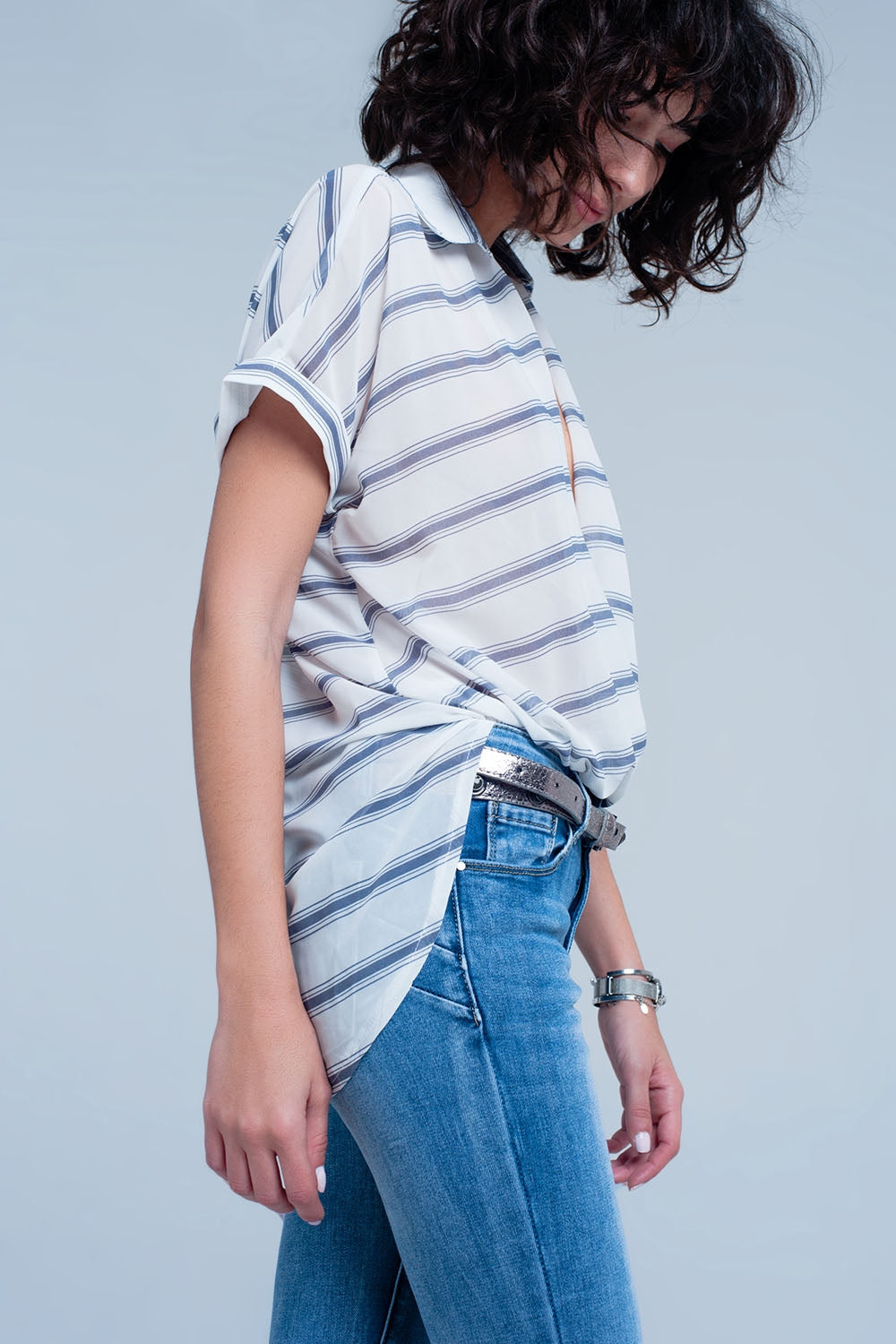White short sleeve drape wrap blouse with blue striped design