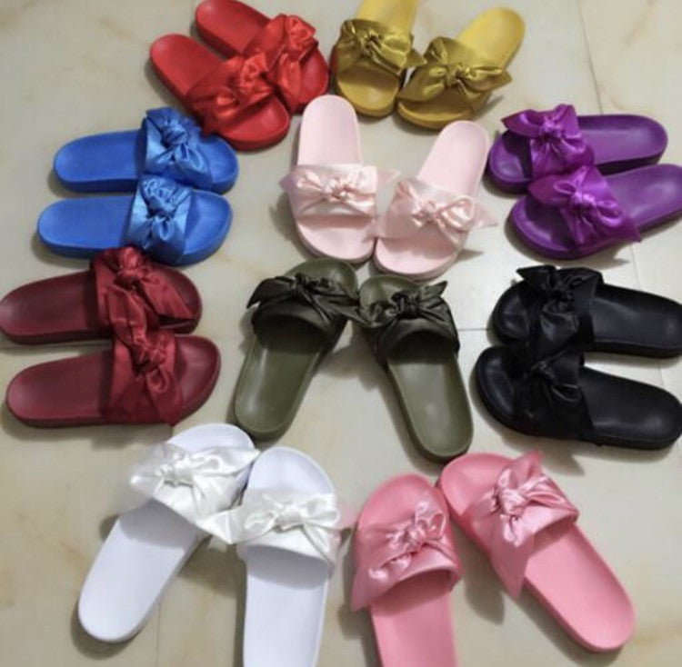 official photos 20d1b 56674 Fenty Bow Slides