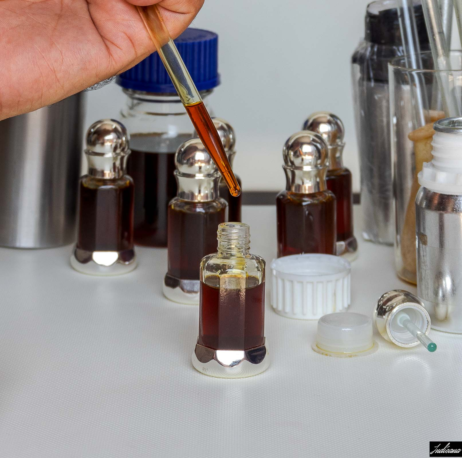 Oud Oil from India Being Transferred to Bottles