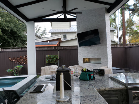 Covered Patio Addition with open gable roof with stained cedar truss, stucco columns, Stucco ceiling and Soffit with Decorative wood rafters, Outdoor Fire Place with Artic white marble ledger stone, Covered outdoor Kitchen with Marble Ledger stone, granite countertops, and Perlick keggerator with beer tap, and Grilling equipment.