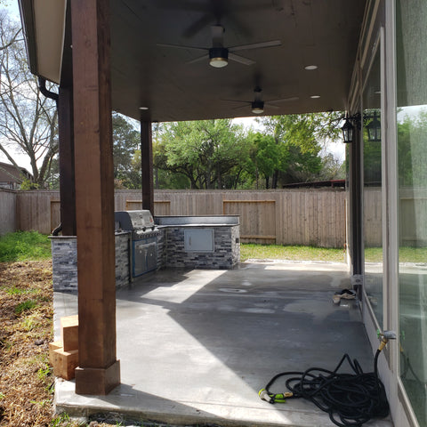 Covered Patio Addition with Single Pitch, half gable roof, Stained and sealed Cedar columns, stained and sealed Cedar ceiling and Soffit, Covered outdoor Kitchen with Ledger stone, granite countertops, and Webber Grilling equipment.