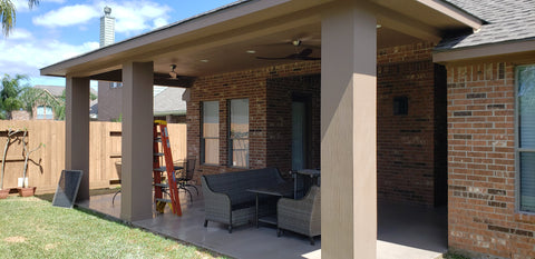 "Covered Porch/patio cover with 16""×16"" James Hardie Columns, James Hardie Panel ceiling & Soffit, GAF Timberline HDZ Shingles in Weathered wood, & Monte Carlo Maverick II 60"" Ceiling Fan in Dark walnut & Black. ."