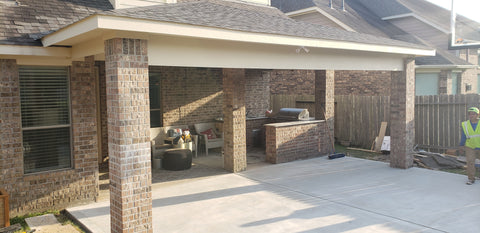 Covered Porch/patio cover with Brick Columns, James Hardie Panel ceiling & Soffit, CertainTeed Landmark Shingles in Weathered wood, & outdoor Basketball court