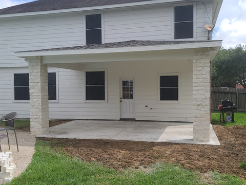 Covered Patio Addition with Limestone chop block columns and hip roof Design build