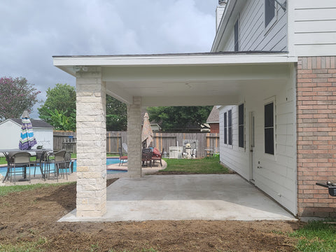 Covered Patio Addition with Limestone chop block columns and hip roof with james hardie soffit and fascia