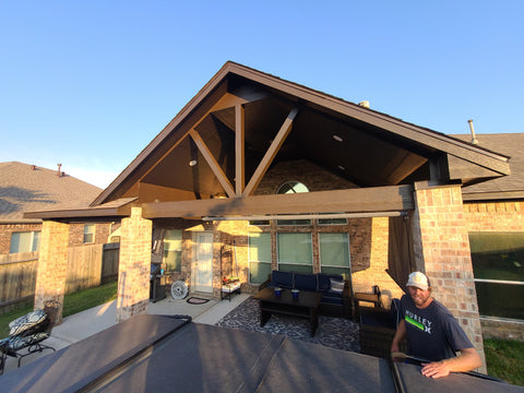 Covered patio addition with vaulted ceiling, gable roof, and brick columns 2