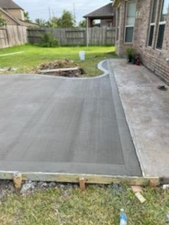 Curved-free form concrete patio addition