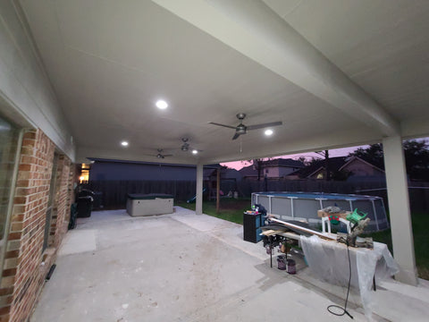 Large Covered patio addition ceiling with james hardie cedar mill soffit lighting and fans 2
