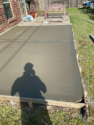 concrete patio addition with rounded corners