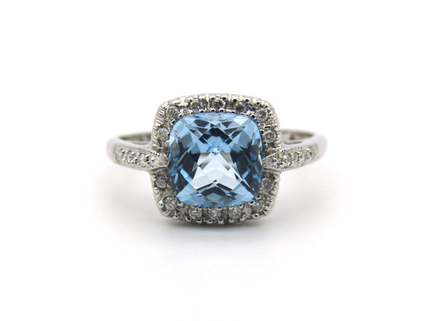 14K gold blue topaz and diamond ring.