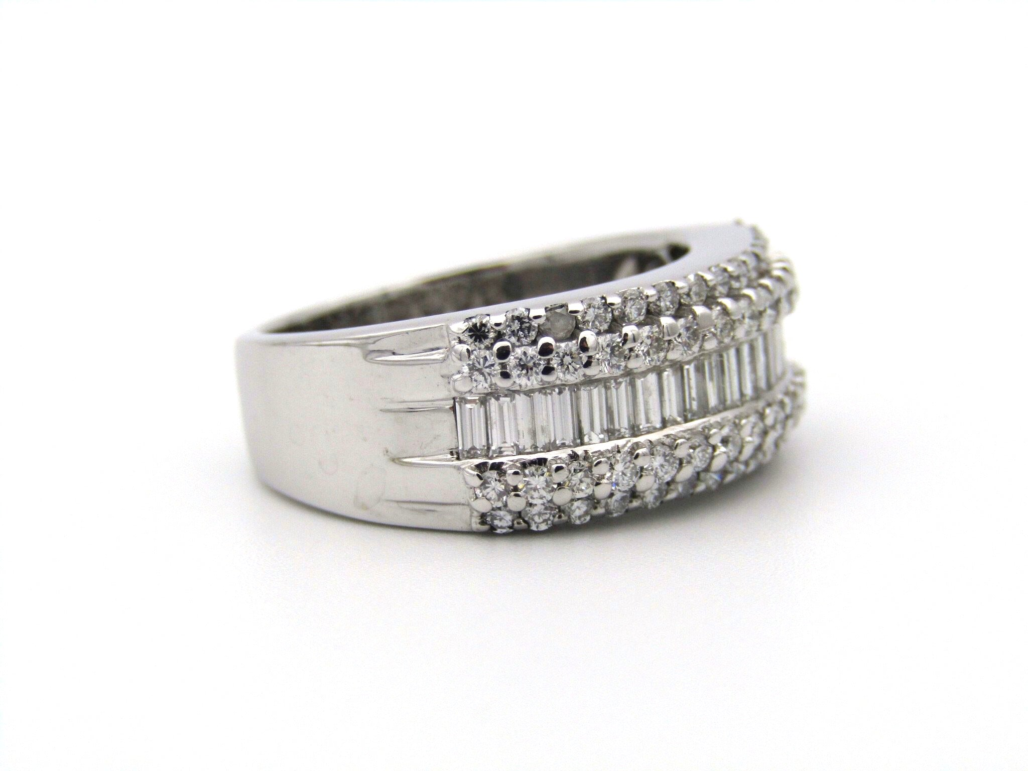 18K gold baguette and round brilliant cut diamond ring.