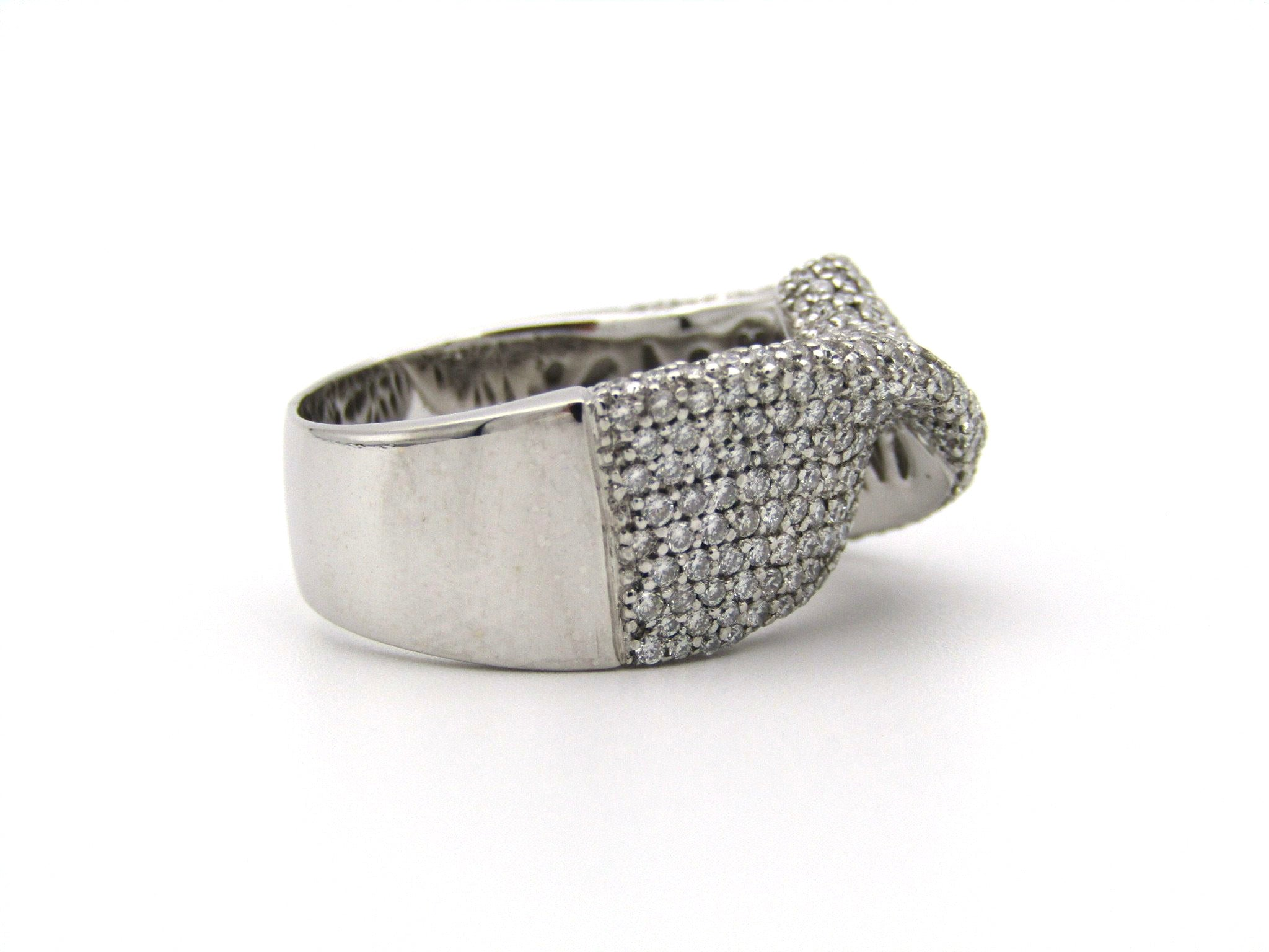 18K white gold diamond twist ring.