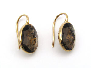 18kt gold smokey quartz earrings by designer Pomellato.