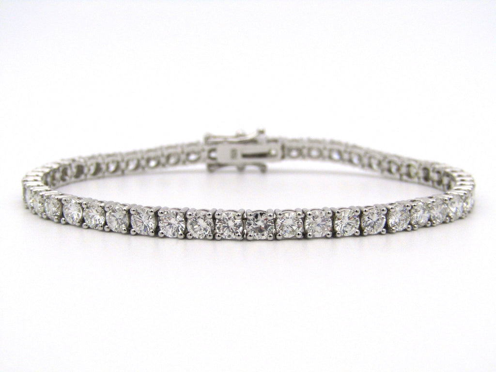 18K white gold diamond tennis bracelet.