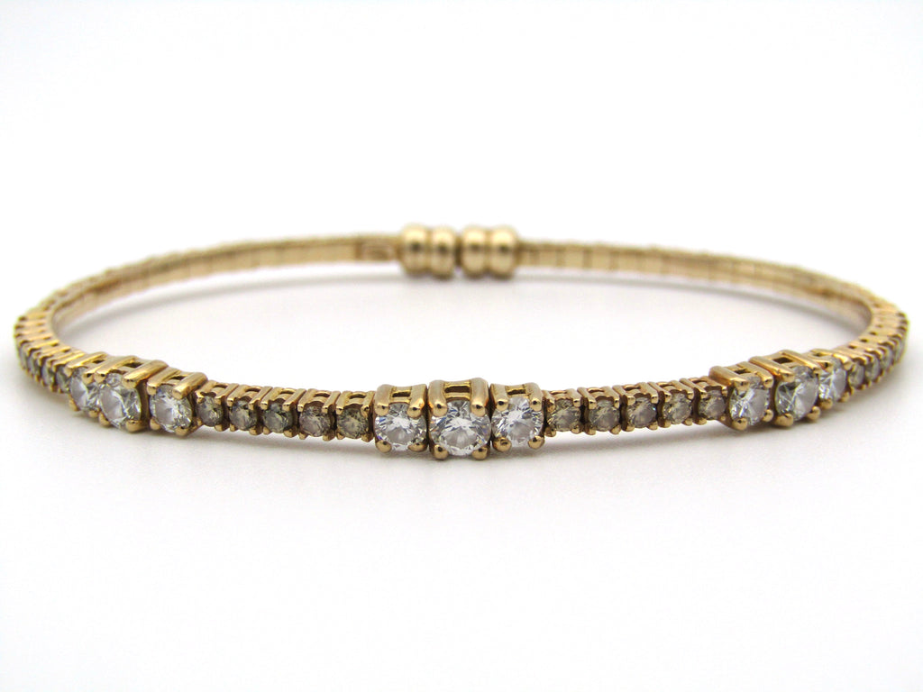 18K gold colourless and brown diamond bangle.