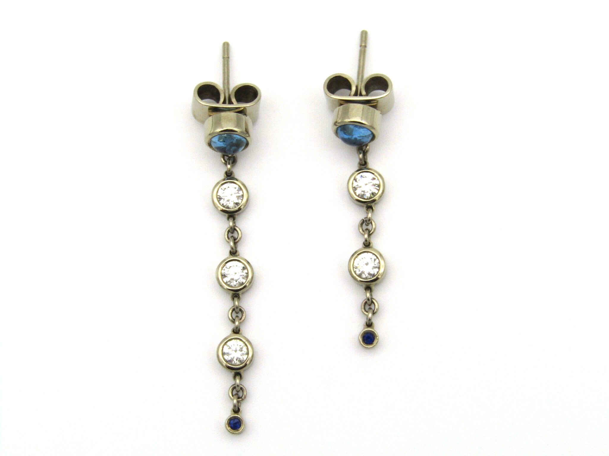 18kt gold diamond and blue topaz earrings by Orpheo.
