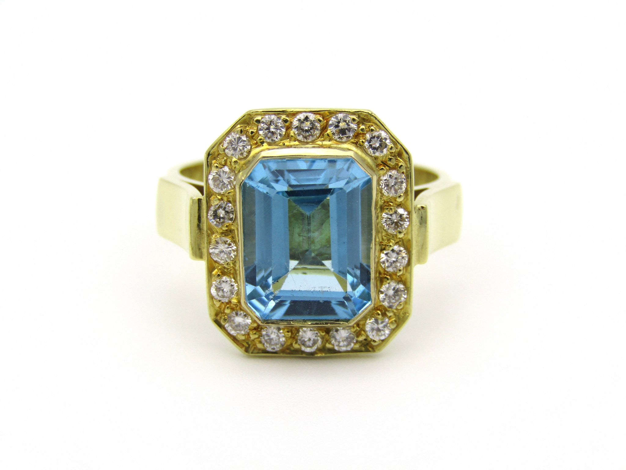 18kt yellow gold blue topaz and diamond ring.