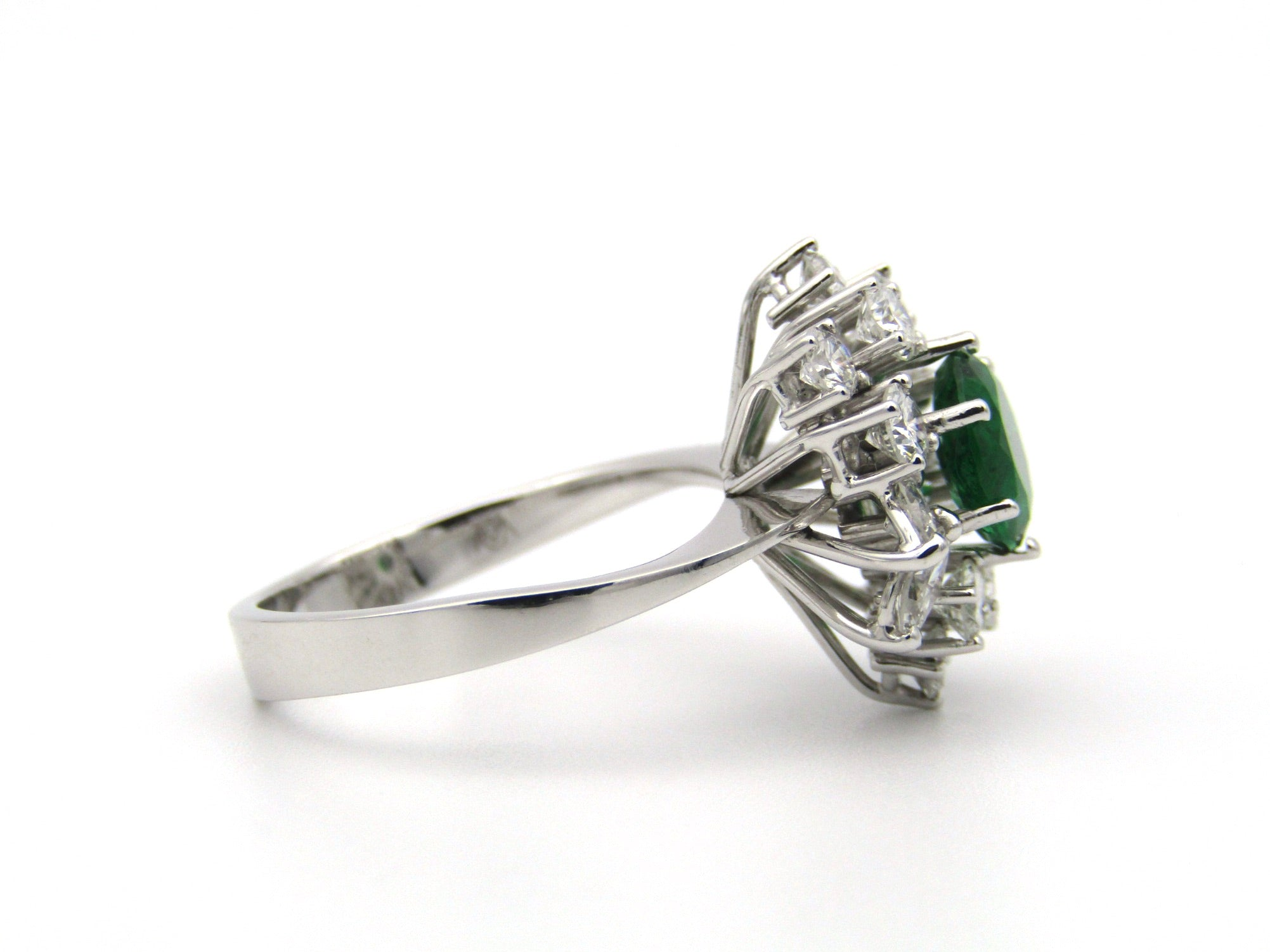 18K gold emerald and diamond ring.