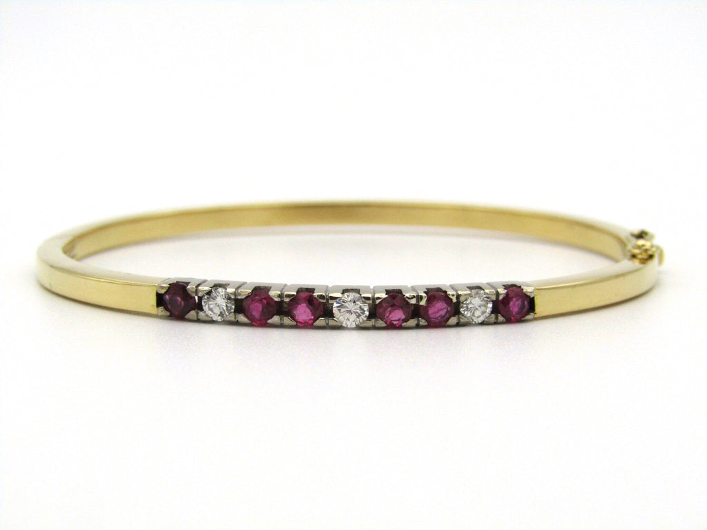 18kt gold rubies and diamonds catch bangle.