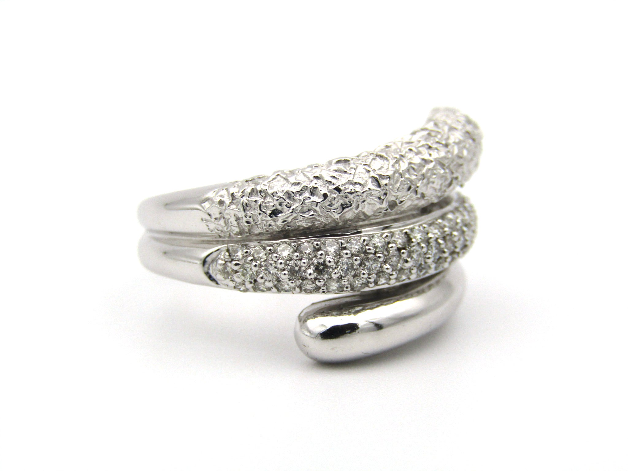 9K gold diamond twist ring.