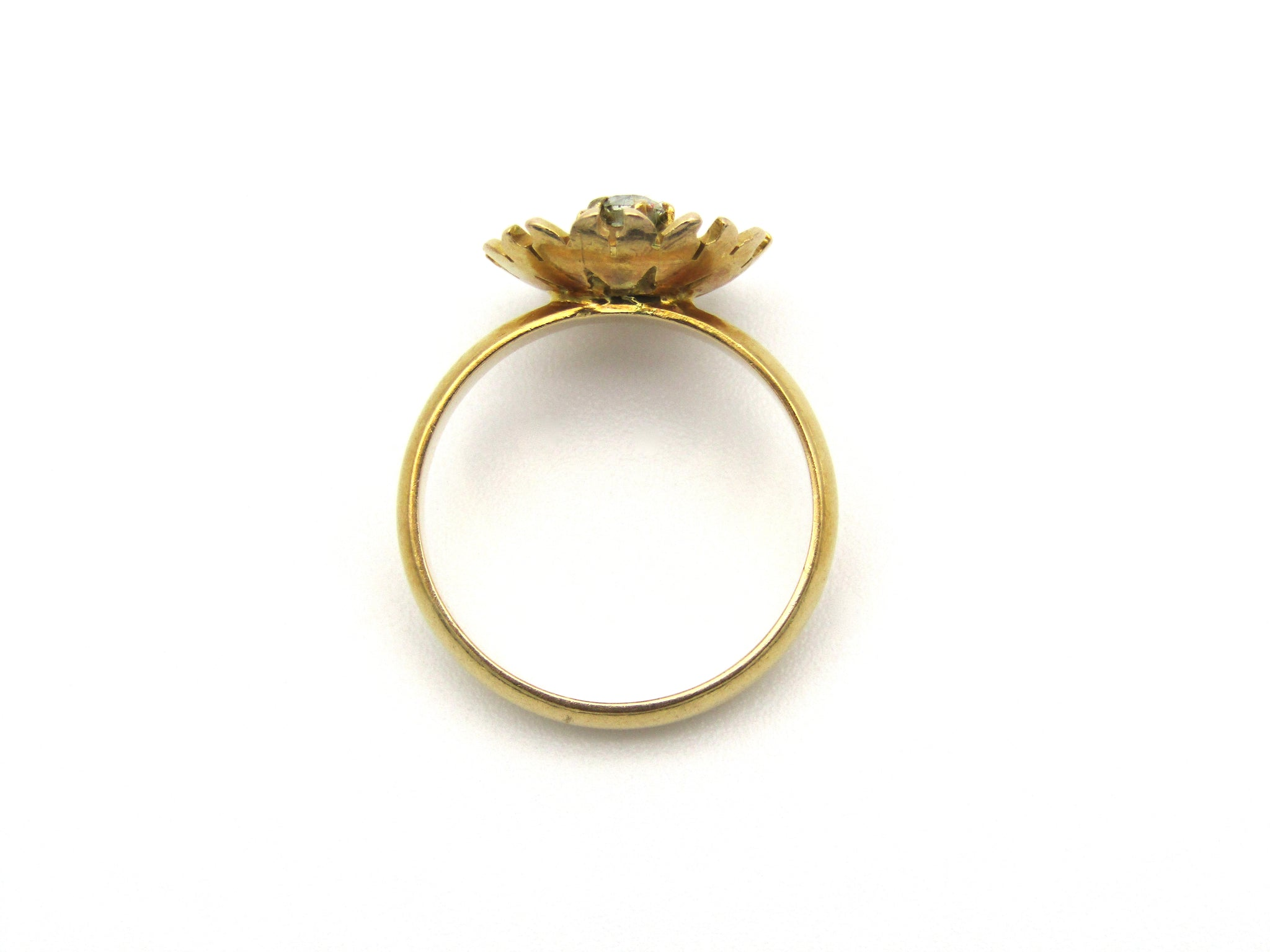 18kt gold diamond ring.