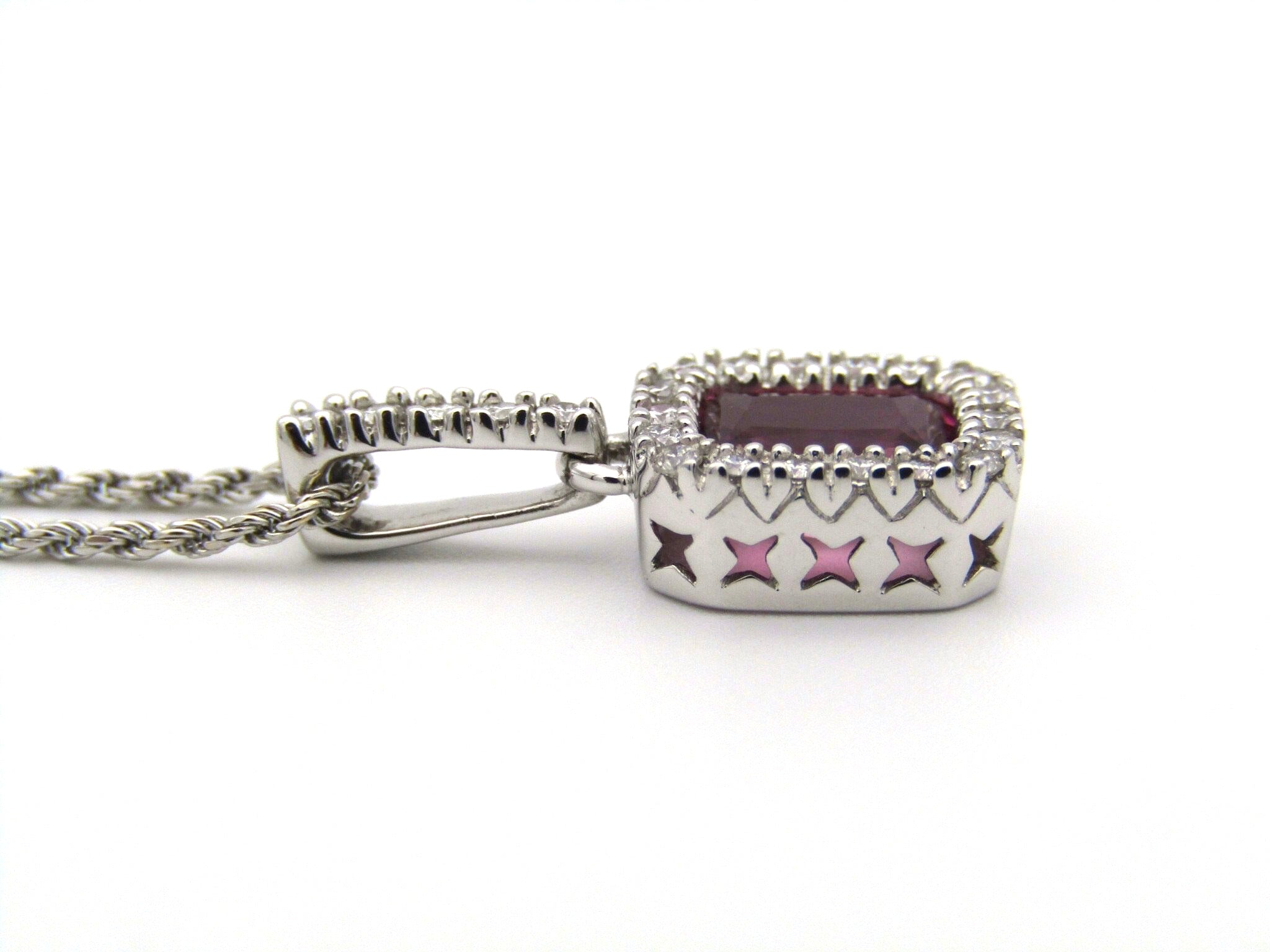 14kt white gold Pink Tourmaline and diamonds pendant.