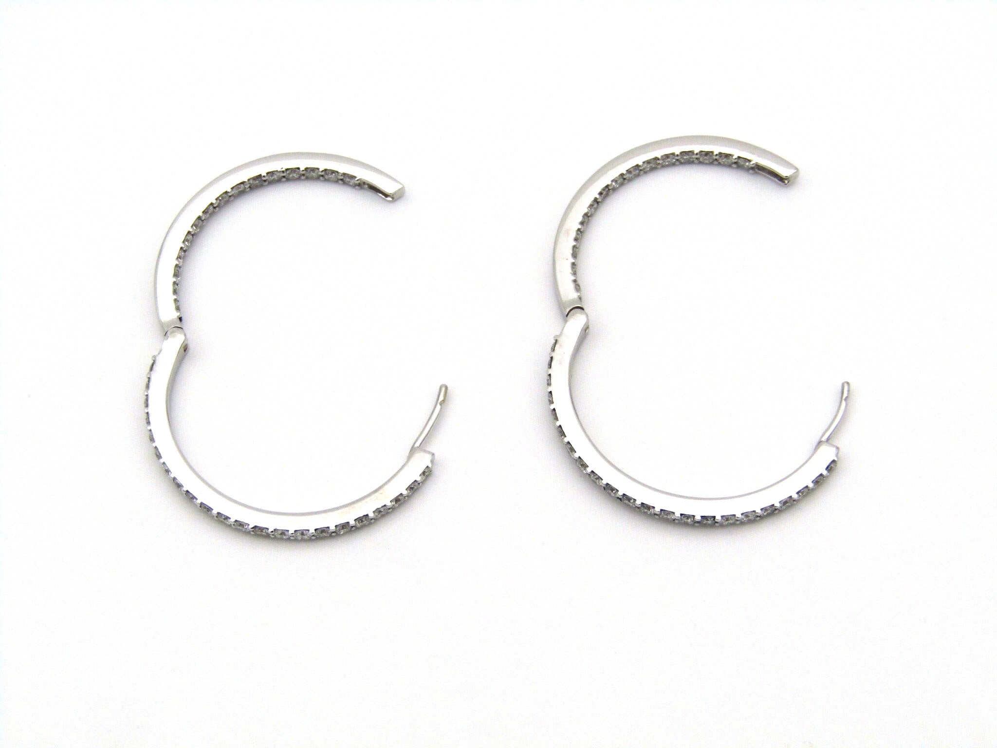 18K white gold diamond hoop earrings.
