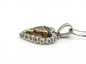 18kt gold cognac diamond pendant.