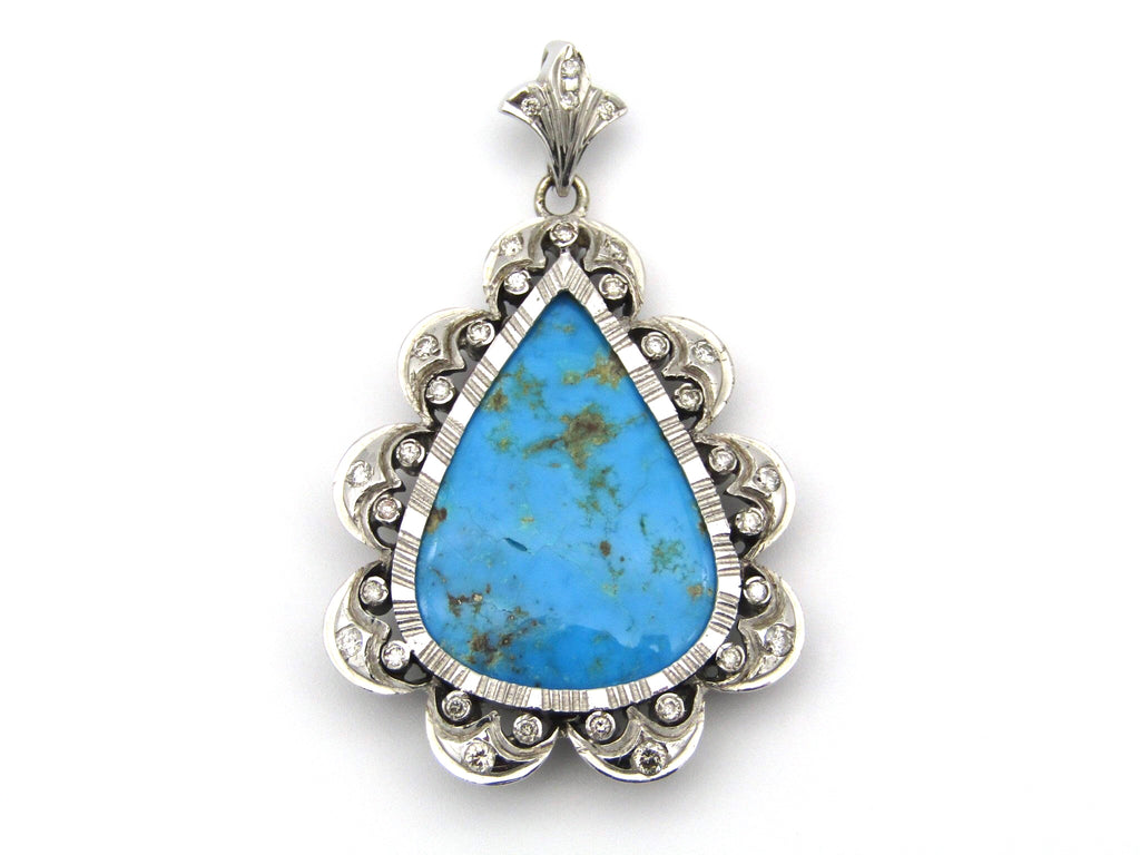 18kt white gold turquoise and diamond pendant.
