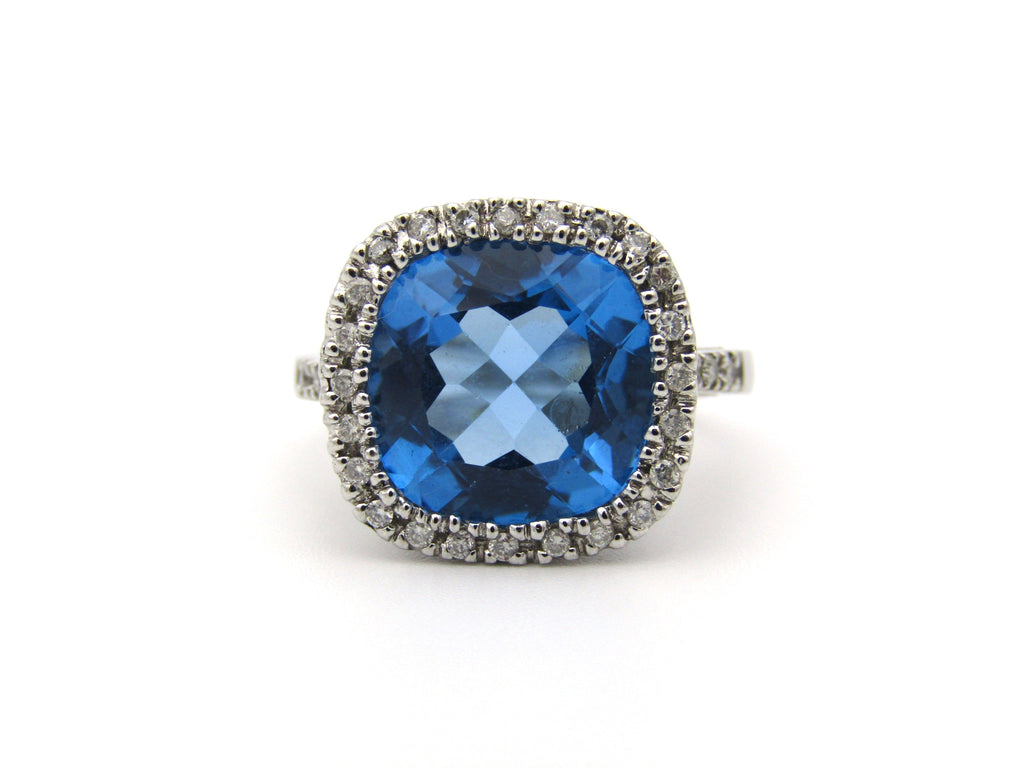 9K gold blue topaz and diamond ring.