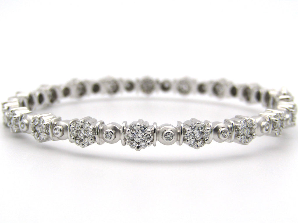 18K gold diamond bangle.