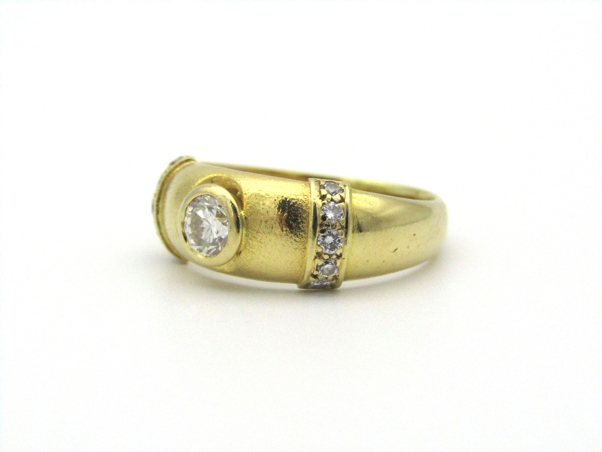 18kt gold diamond ring by Friedman's.
