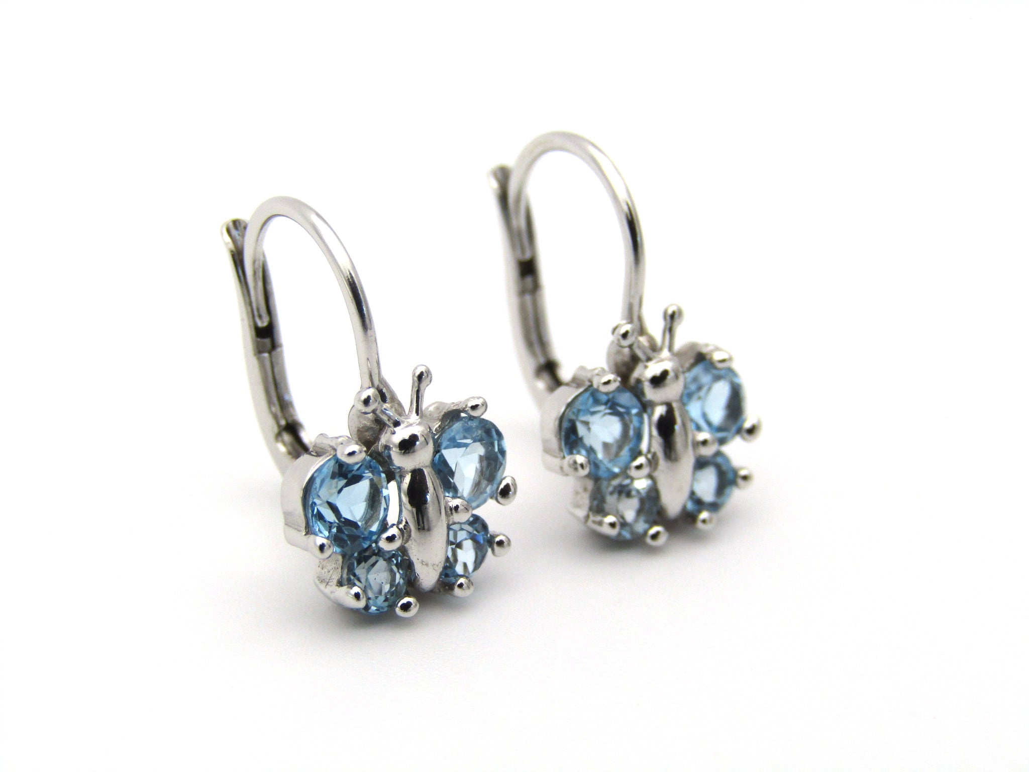 18K gold blue topaz butterfly earrings.