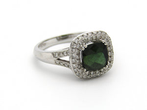 14kt gold green tourmaline and diamond ring.