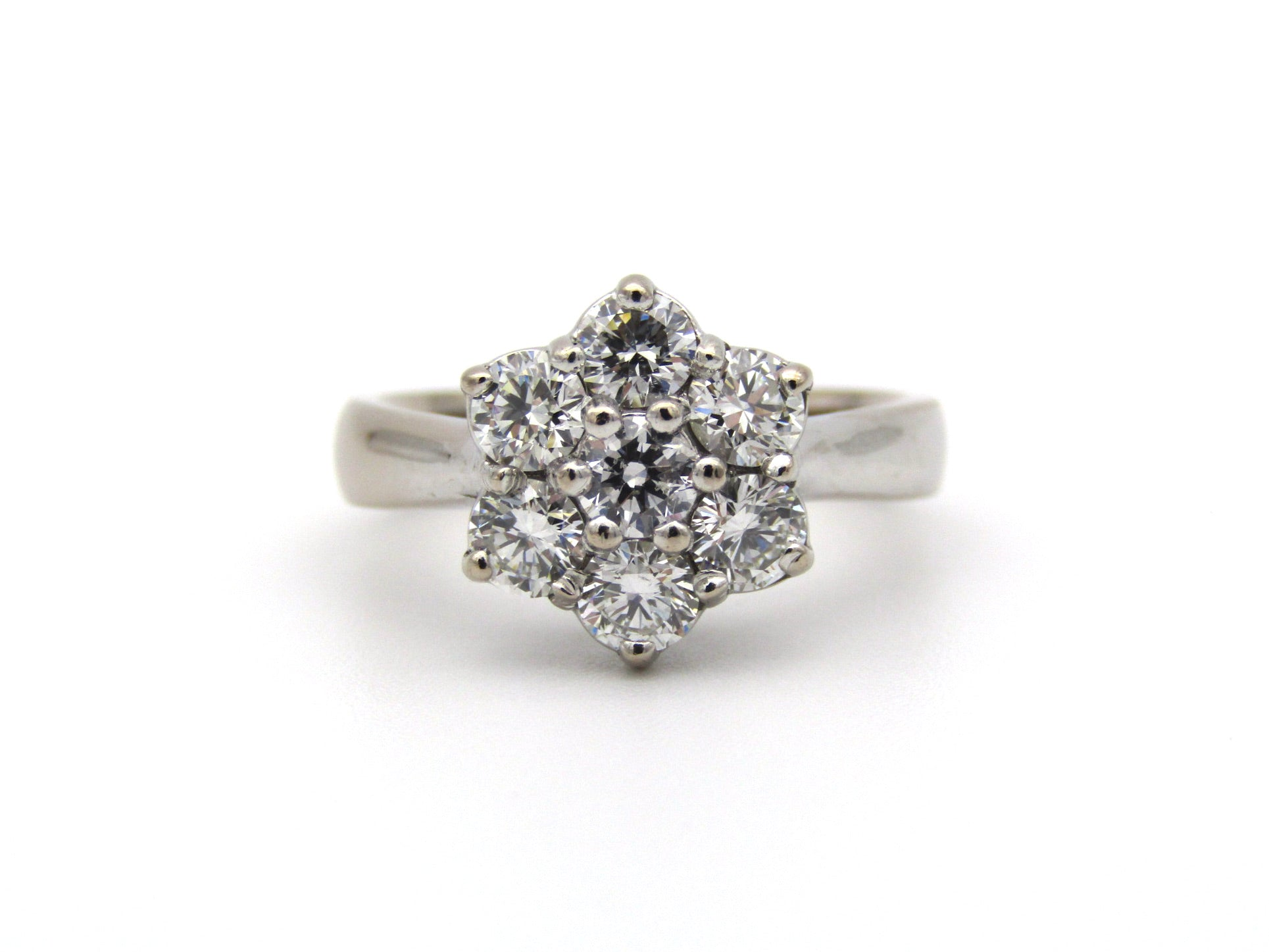 18K gold diamond flower ring by Browns.