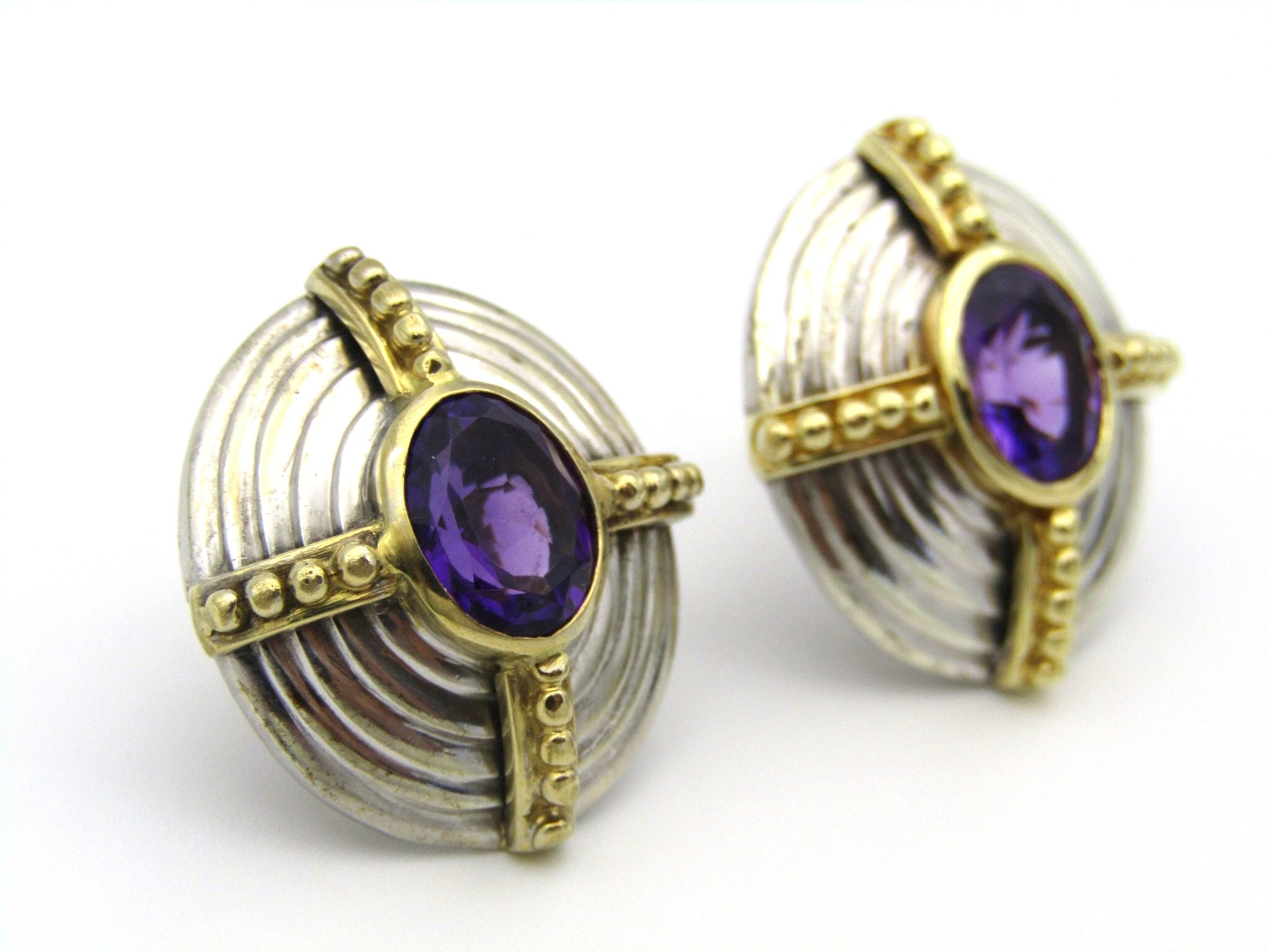 A pair of 18kt and 9kt gold amethyst earrings.