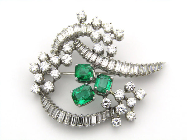 18K gold emerald and diamond brooch.