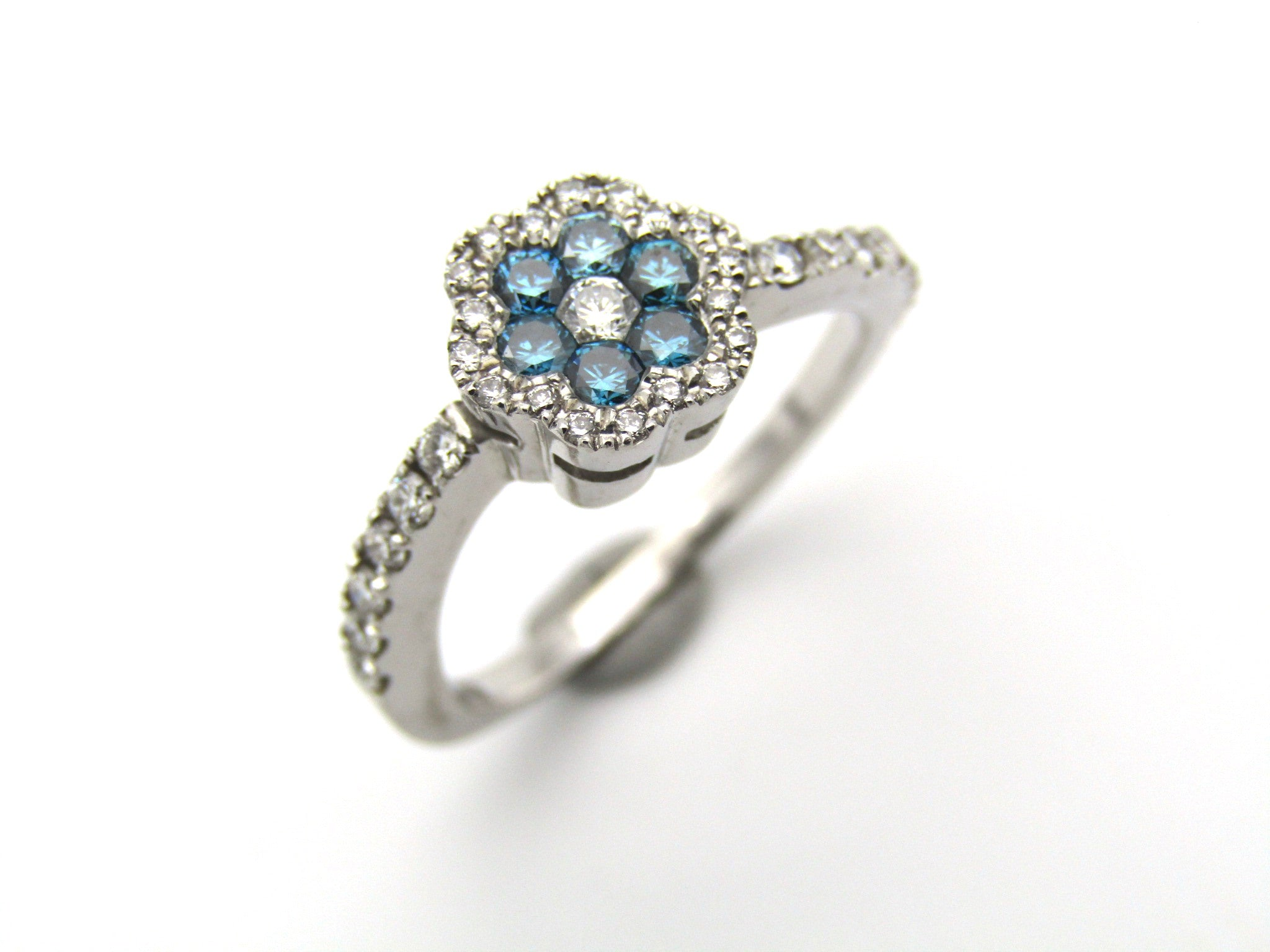 18K gold blue and colourless diamond flower ring.