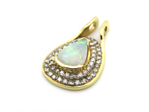 18K gold opal and diamond pendant.