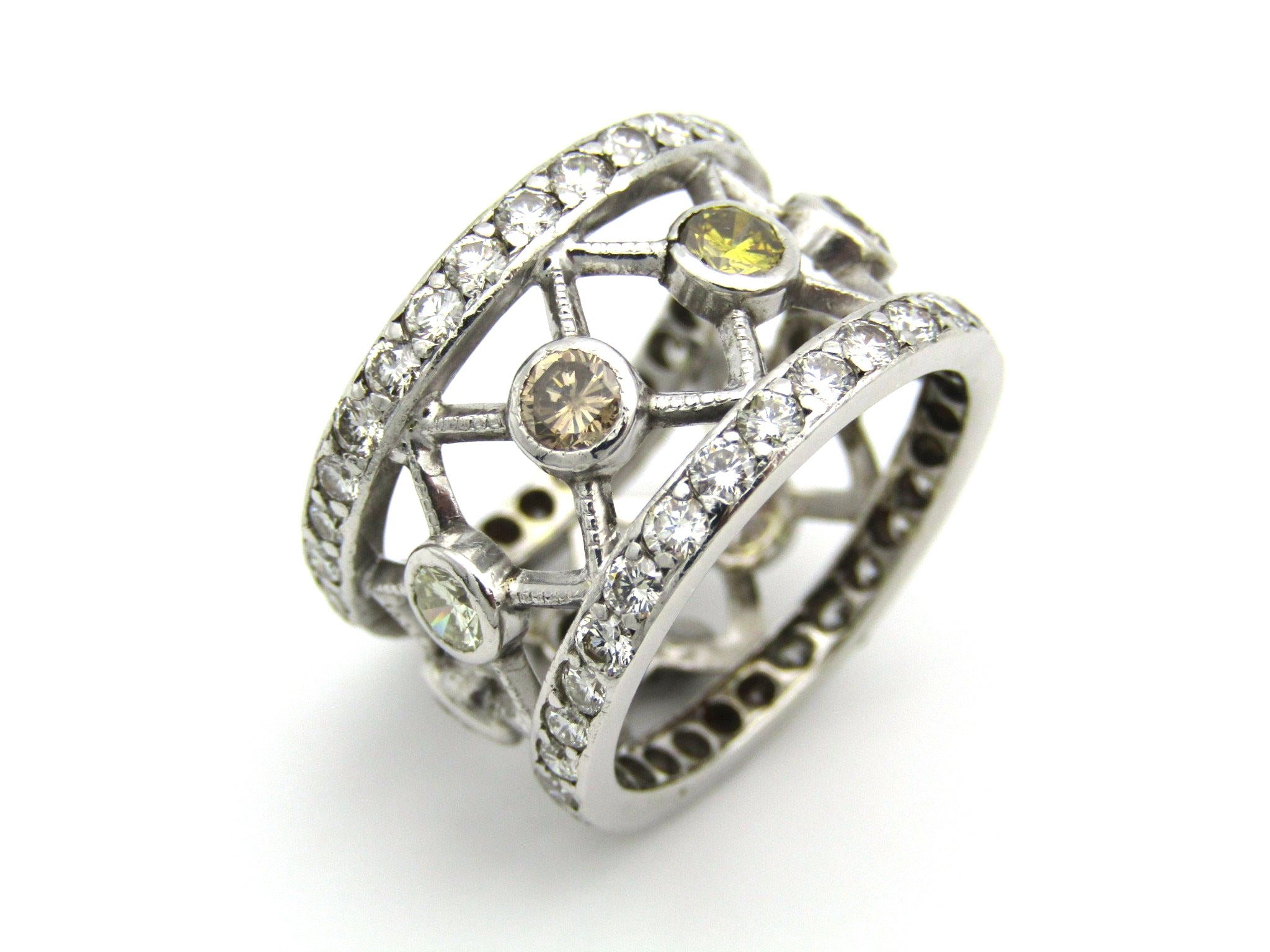 9kt gold fancy and colourless diamond ring.