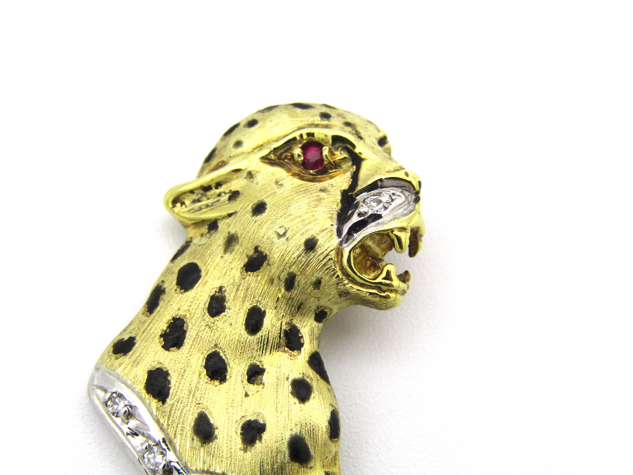 14kt gold Cartier style ruby and diamond leopard pendant.