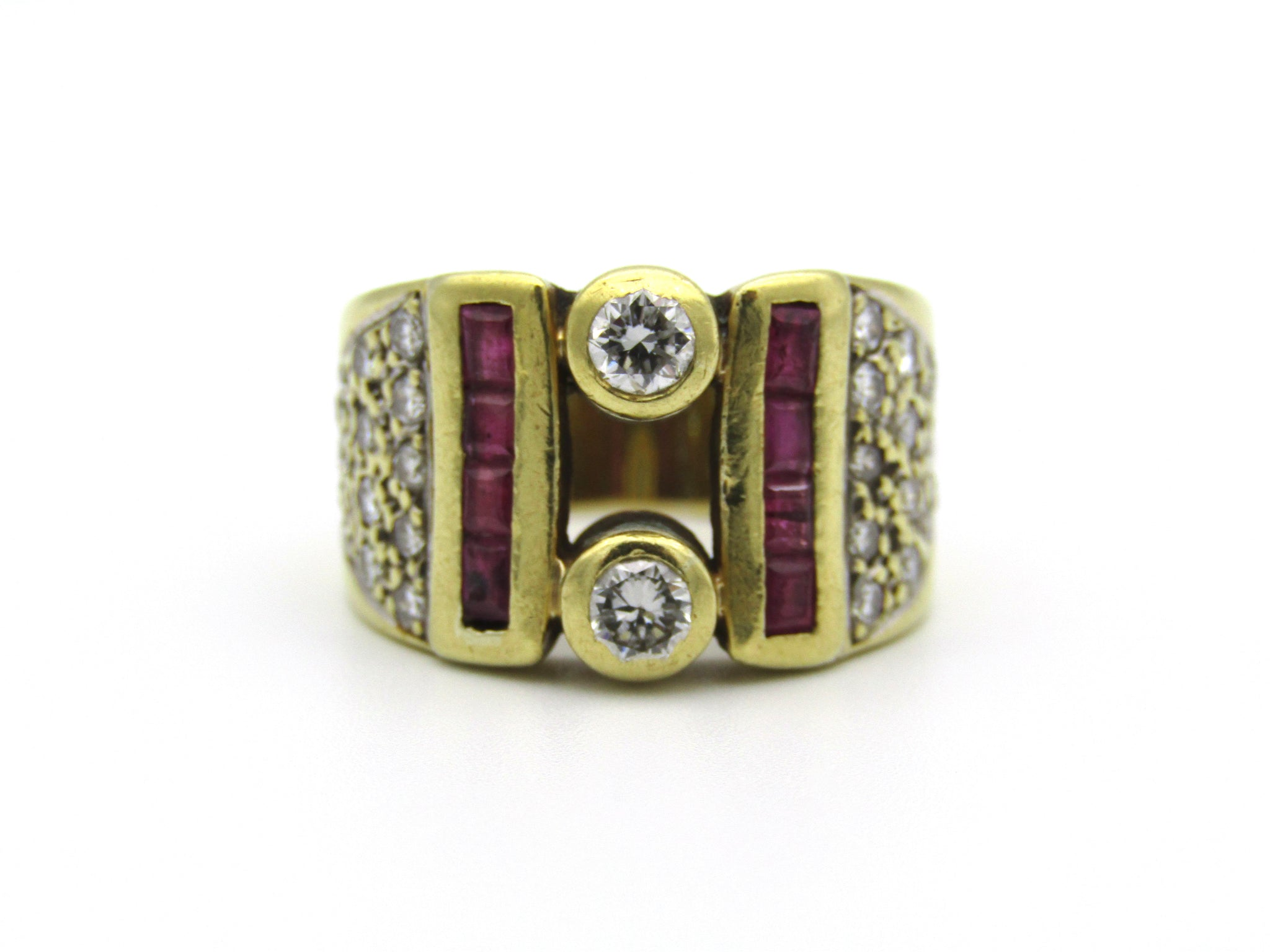 18kt gold diamond and ruby ring.
