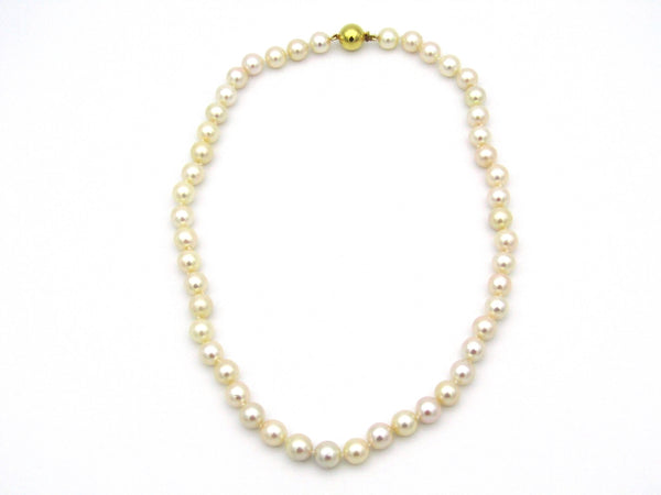 String of Akoya cultured pearls with 9K gold ball clasp.